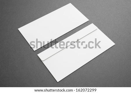 Blank envelopes on dark background. Front and back side. - stock photo