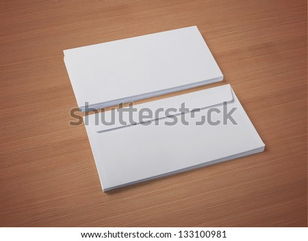 Blank envelopes on wooden background with soft shadows.  / stationary  / for another blank templates visit my gallery - stock photo