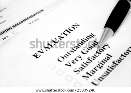 Blank evaluation with a pen. Used a shallow depth of field with selective focus. - stock photo