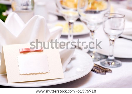 Blank event Guest Card on restaurant table - stock photo