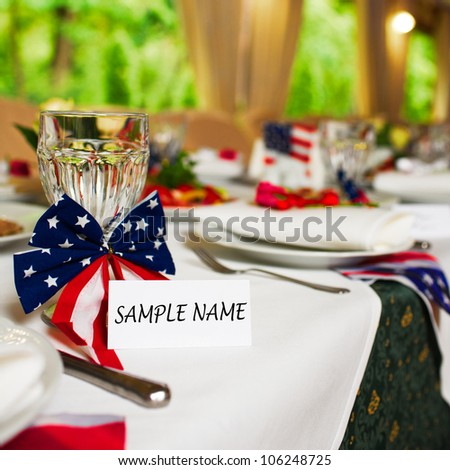 Blank event Guest Card on restaurant table with american flag - stock photo