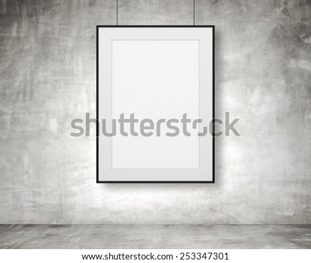 blank frame hanging on wall in room - stock photo