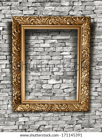 Blank frame on a concrete wall. - stock photo