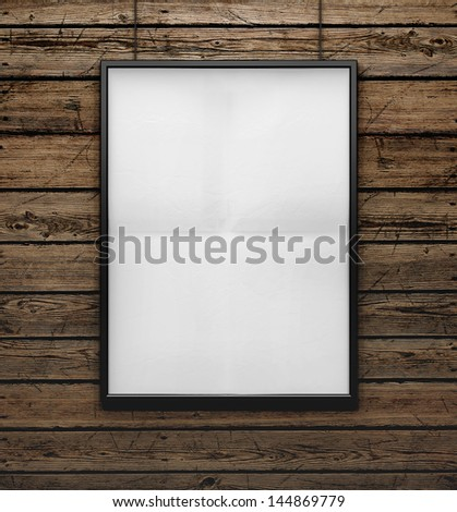 blank frame on a wood wall - stock photo