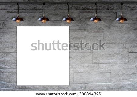 Blank frame on Granite stone decorative brick wall with lamp - stock photo