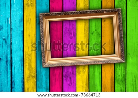 Blank Frame on Multicolored Wood Background - stock photo