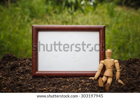 Blank frame with a wooden dummy.