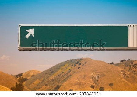 Blank Freeway Exit Sign with Arrow - stock photo