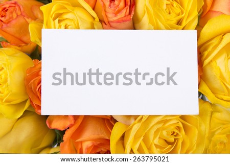 blank gift card and beautiful bouquet of orange and yellow roses - stock photo