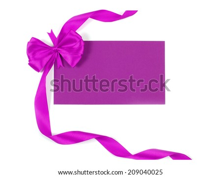 Blank gift tag tied with a bow - stock photo