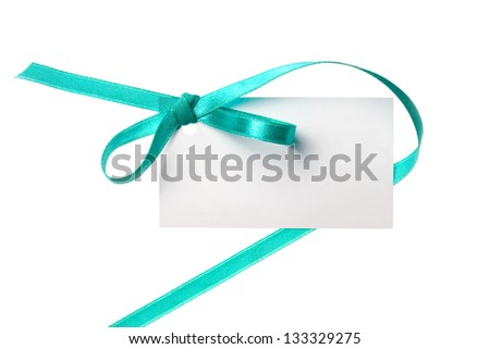 Blank gift tag tied with a bow of green satin ribbon. Isolated on white, with soft shadow - stock photo