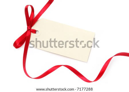 Blank gift tag tied with a bow of red satin ribbon.  Isolated on white, with soft shadow.