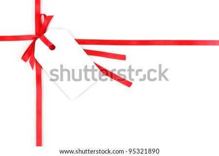 Blank gift tag with bow on red satin ribbon isolated on white - stock photo