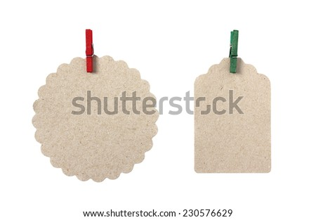 Blank gift tags made from brown eco-friendly kraft paper in different shapes with red and green peg - isolated on white background - stock photo