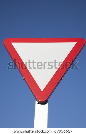 Blank Give Way Sign against Blue Sky Background