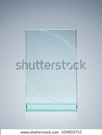 Blank glass award over gray background with copy space - stock photo