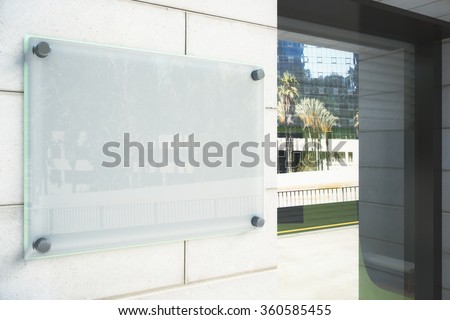 Blank glassy signboard on the wall outdoor, mock up - stock photo