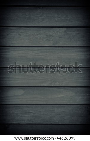 Blank gloomy dark graphite toned boards texture abstract with dark vignette, planks surface background in vertical orientation, nobody - stock photo