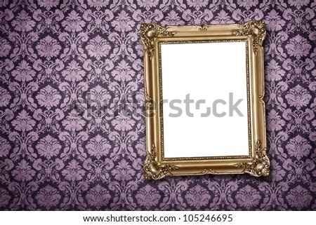 Blank gold picture frame at the ornate wall with clipping path - stock photo