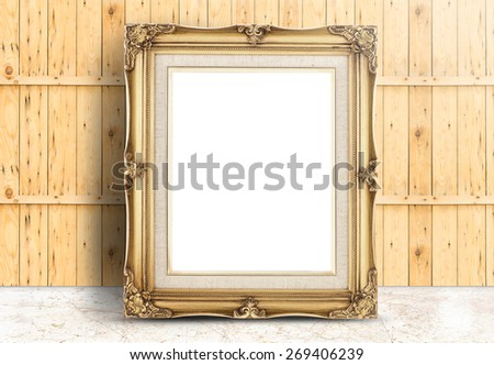 Blank Golden Vintage frame on marble floor and plank wooden wall,Template mock up for adding your design - stock photo