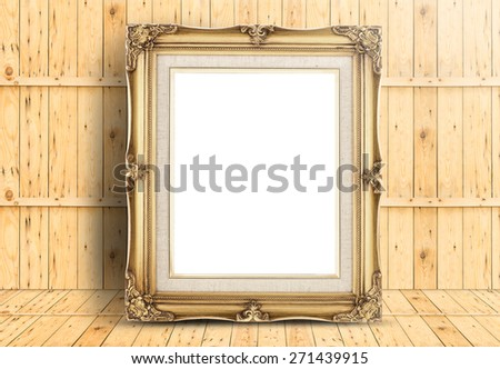 Blank golden Vintage frame on wood floor and plank wooden wall,Template mock up for adding your design. - stock photo