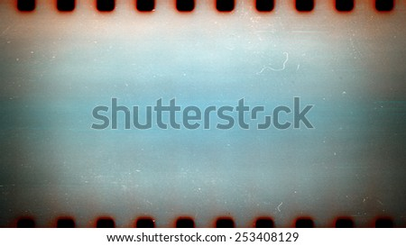 Blank grained film strip texture background with heavy grain dust and scratches - stock photo