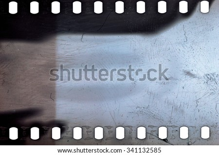 Blank grained noisy film strip texture background