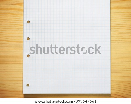 Blank graph paper on wood background - stock photo
