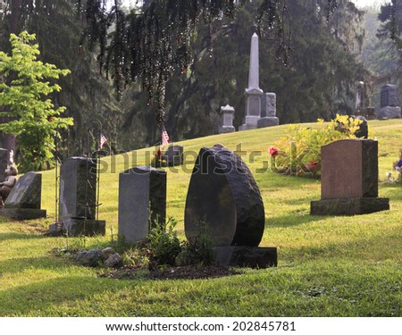 Blank graves in a graveyard in early morning - stock photo
