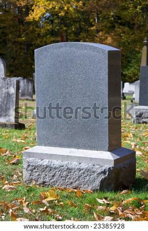 Blank gravestone in graveyard during the autumn season - stock photo