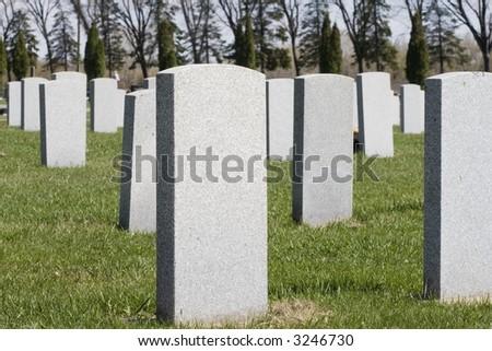 Blank gravestones in a cemetery. - stock photo