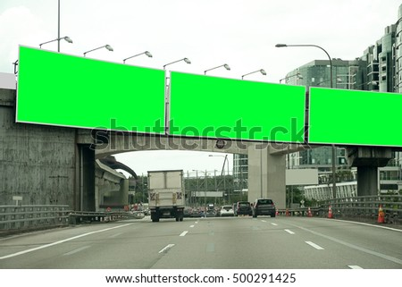 Blank Green Billboard or Road Sign on the highway.