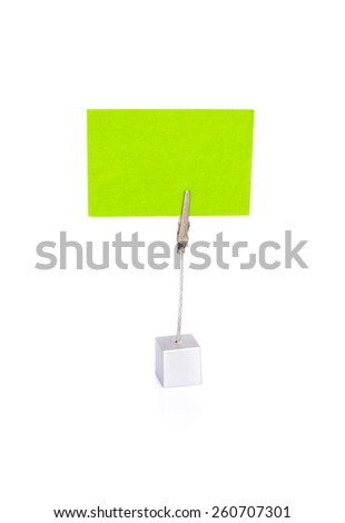 Blank green card to be replaced by your business card or for your message in card holder on white background with shadow and reflection - stock photo