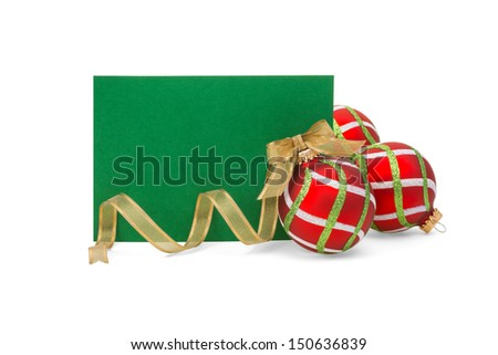 Blank green card with red, green, white Christmas balls and gold ribbon on white.  Copy space. - stock photo