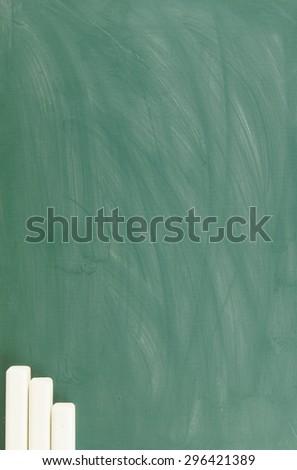 Blank green chalkboard as background - stock photo