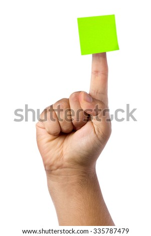 Blank green postit glued on top of forefinger isolated  - stock photo