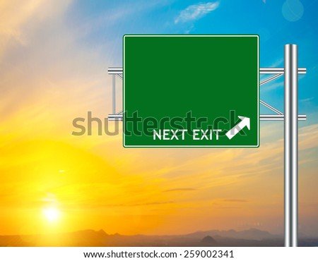 Blank Green Road Sign concept with resplendent clouds and sky.