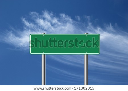 Blank green road sign isolated on blue sky background.