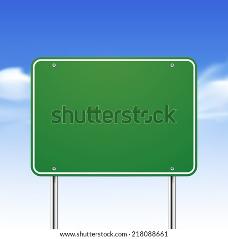 blank green traffic road sign over blue sky