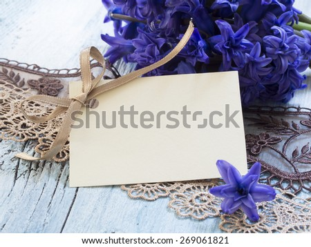 blank greeting card with fresh purple flowers - stock photo