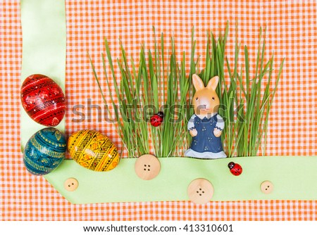 Blank, greeting easter card with bunny, green grass and handmade easter eggs - stock photo