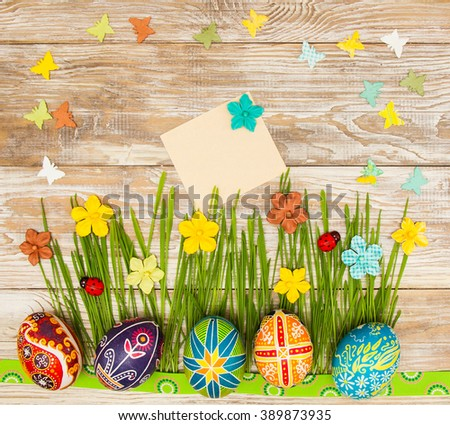Blank, greeting easter card with easter eggs, bunny and green grass on shabby wooden background