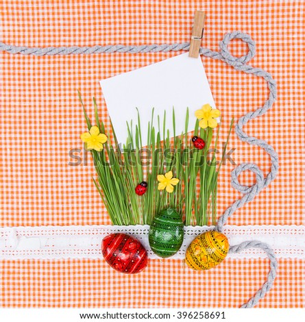 Blank, greeting easter card with green grass and handmade easter eggs.  Your text here - stock photo