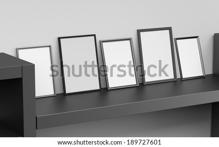 blank grey frames leaned against wall - stock photo