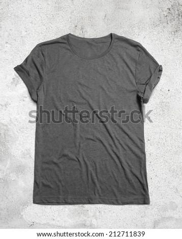 Blank grey t-shirt on concrete floor - stock photo