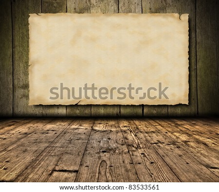 Blank grunge paper on wooden wall - stock photo