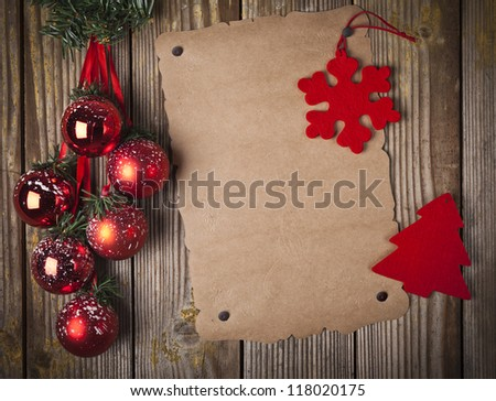 Blank grunge paper over wooden background and christmas ornament - stock photo