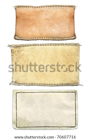 Blank grungy damaged leather jeans' labels, isolated on white background - stock photo