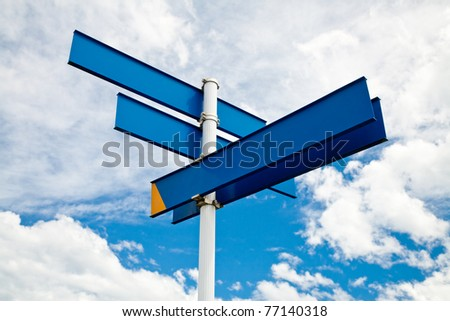 Blank guidepost against cloudy sky - stock photo