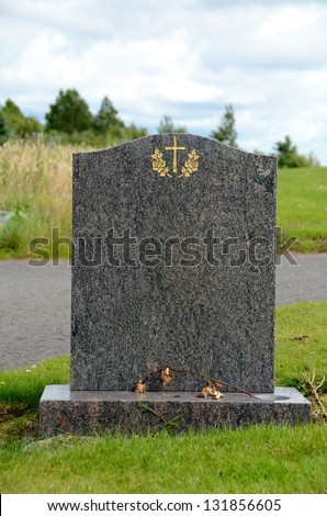Blank headstone with flower - stock photo